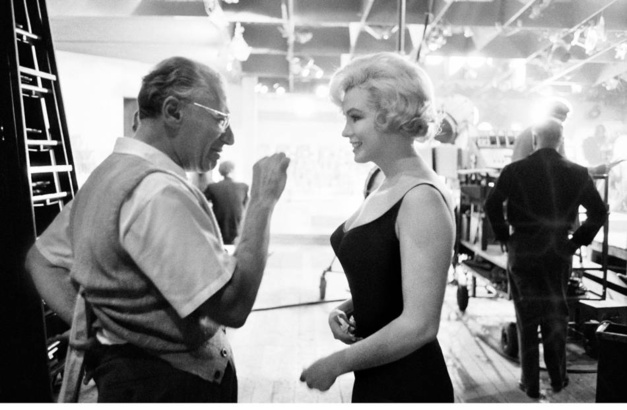 Marilyn Monroe listens to director George Cukor on the set of Lets Make Love Hollywood 1960
