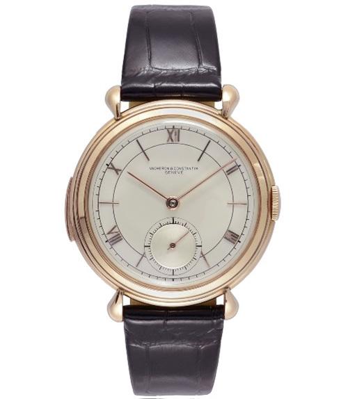 1941 - Montre-bracelet homme, répétition-minute. Or rose 18K, anses gouttes, verrou de répétition sur la carrure, cadran argenté, chiffres romains et index bâtons or rose, petite seconde à 6h.