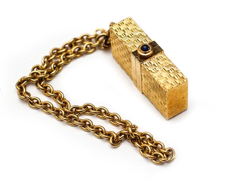 Montre de sac en or jaune de chez Corum, années 60